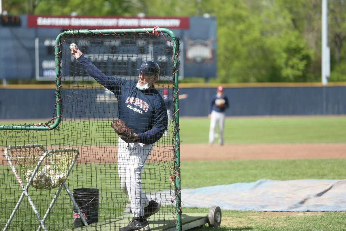 Former UConn baseball coach Andy Baylock, 82, still throws about 400 batting-practice pitches a day as a volunteer assistant at Eastern Connecticut State University.