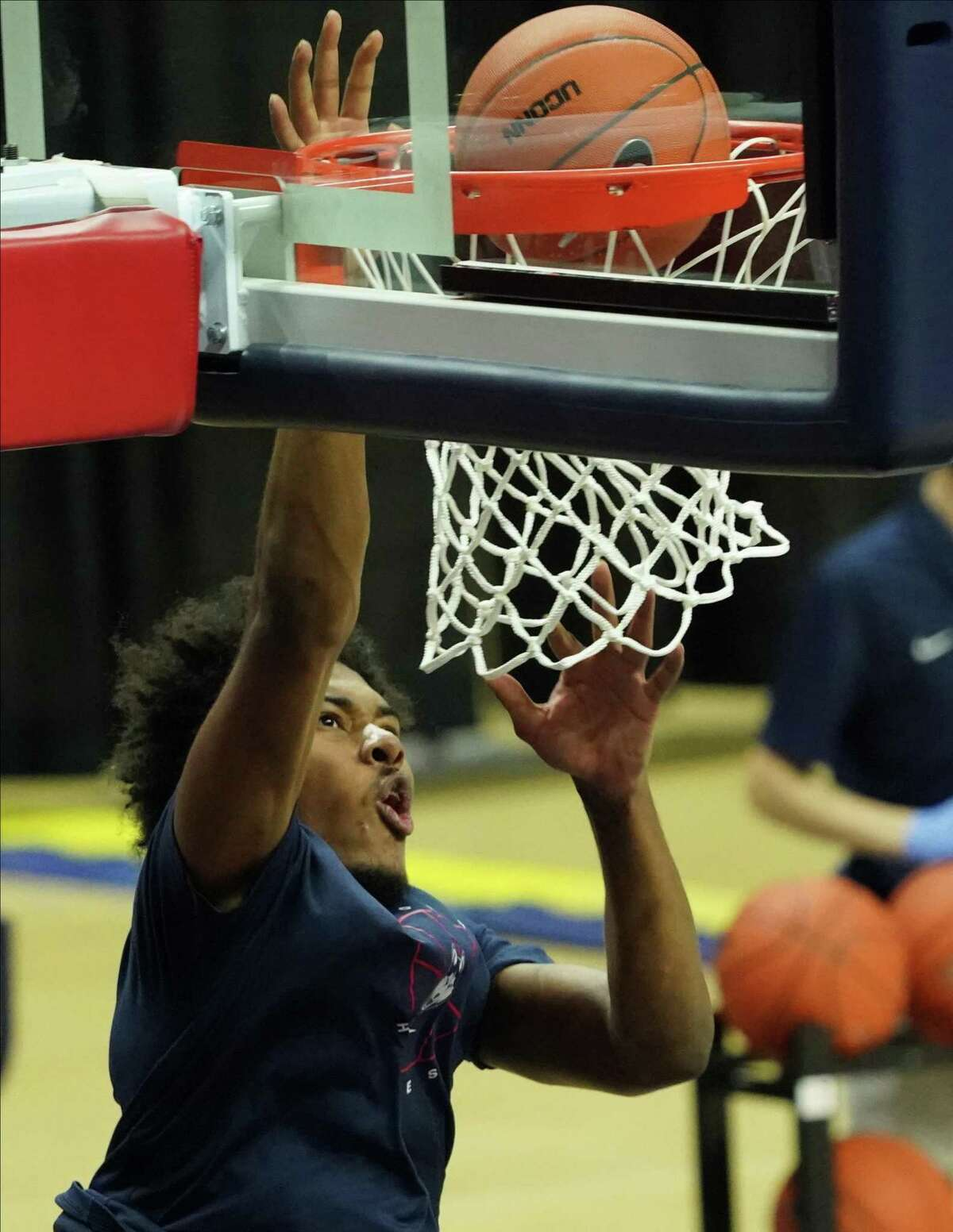 Nov 25, 2020; Storrs, CT, USA; Connecticut Huskies forward Richie Springs (13) warms up before a game against the Central Connecticut State Blue Devils at Gampel Pavilion. Mandatory Credit: David Butler II-USA TODAY Sports