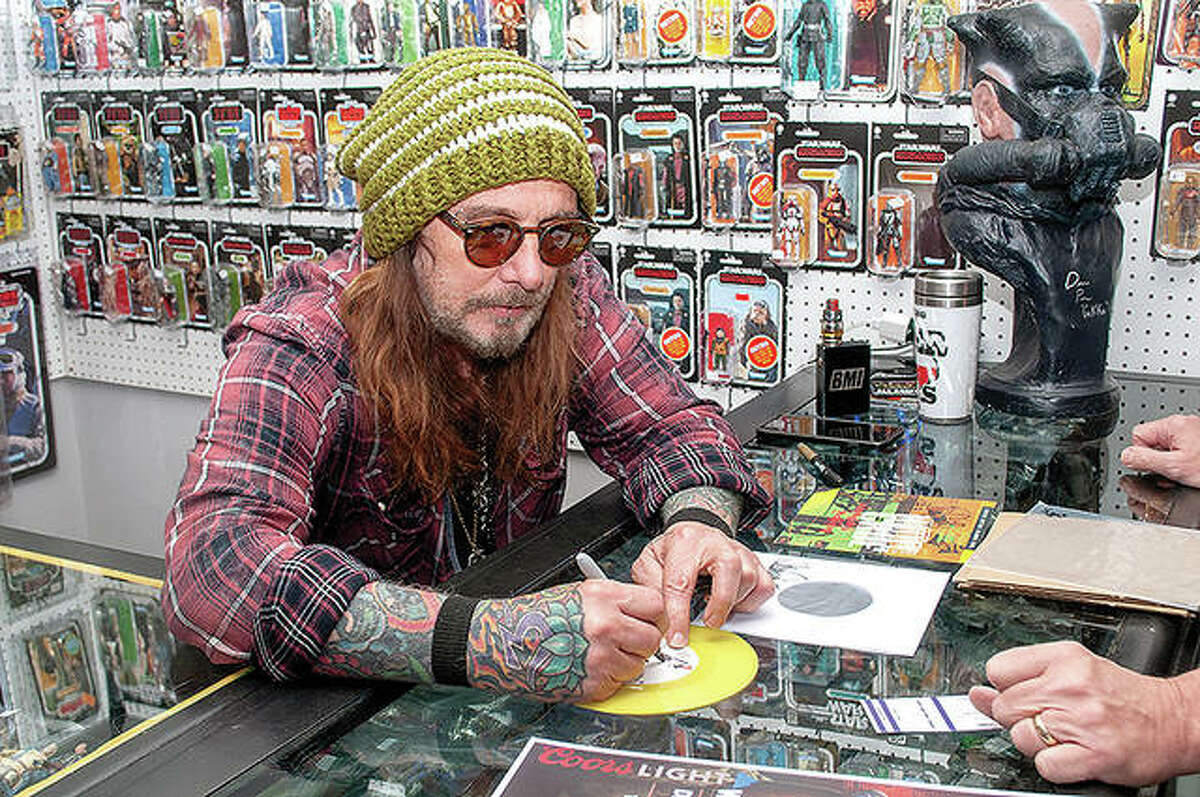 John Corabi, lead singer for the hard rock band Motley Crue from 1992 to 1996 and most recently with The Dead Daisies, visited Destination Toys in Jacksonville on Wednesday. He met with fans before a performance that night at Danenberger's Family Vineyards in New Berlin.