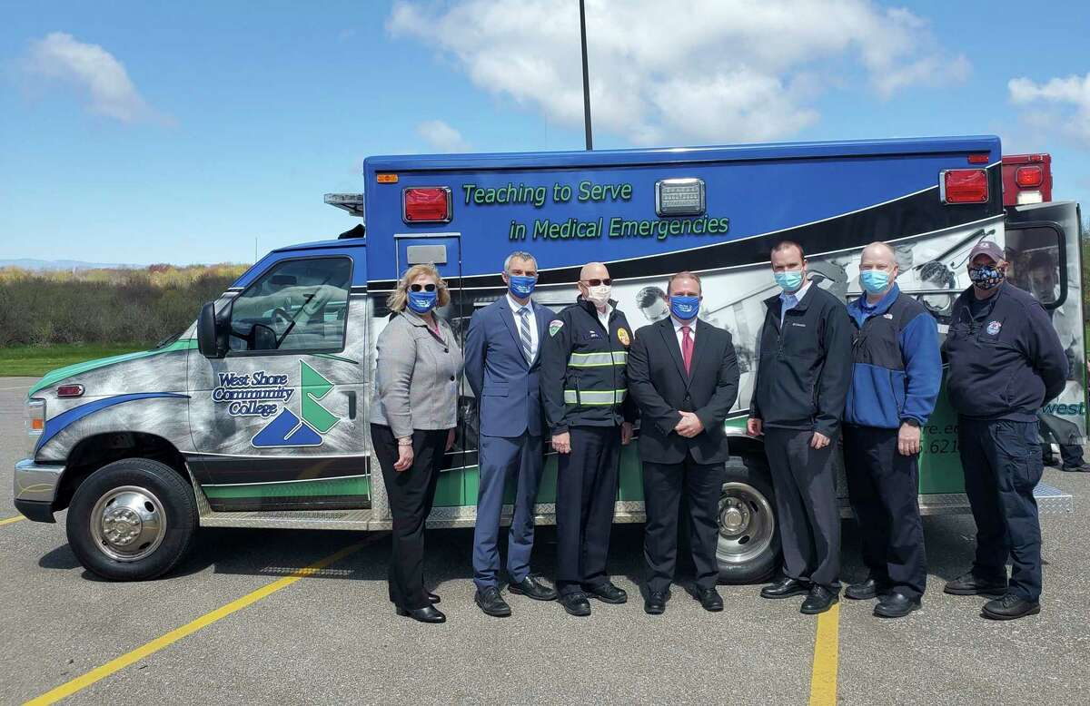 Left to Right: Christy Christmas, Dean of Occupational Programs, Dr. Mark Kinney, Vice President of Academics, Jeff Stockhill, Life EMS Director of North Operations, Scott Ward, President, Dan Yost, Emergency Medical Services Program Director, David Quinn, EMT Lab Instructor, Jim Petrie, Emergency Rescue and Extraction Instructor, in front of WSCC's ambulance donated from Life EMS. (Submitted photo)
