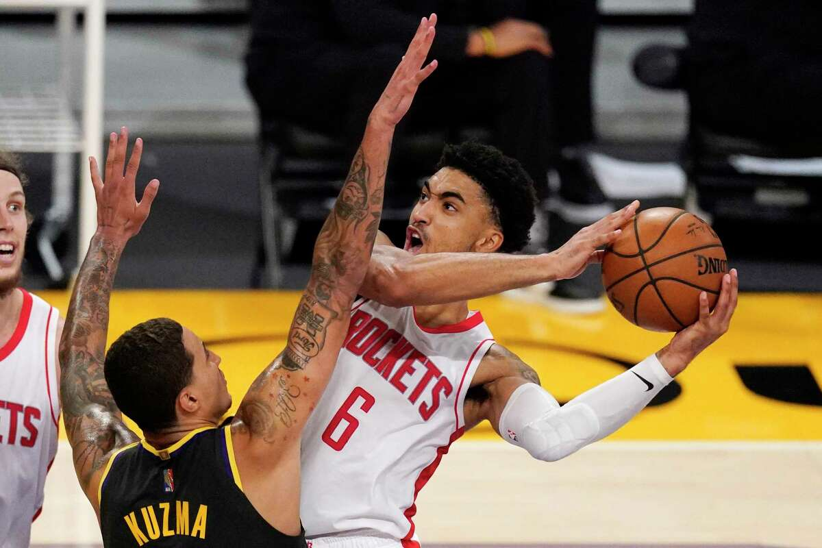 Houston Rockets forward Kenyon Martin Jr., right, shoots as Los Angeles Lakers forward Kyle Kuzma defends during the second half of an NBA basketball game Wednesday, May 12, 2021, in Los Angeles. (AP Photo/Mark J. Terrill)