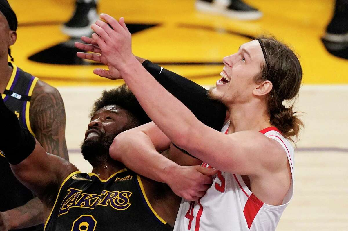 Los Angeles Lakers guard Wesley Matthews, left, and Houston Rockets forward Kelly Olynyk battle for a rebound during the second half of an NBA basketball game Wednesday, May 12, 2021, in Los Angeles. (AP Photo/Mark J. Terrill)