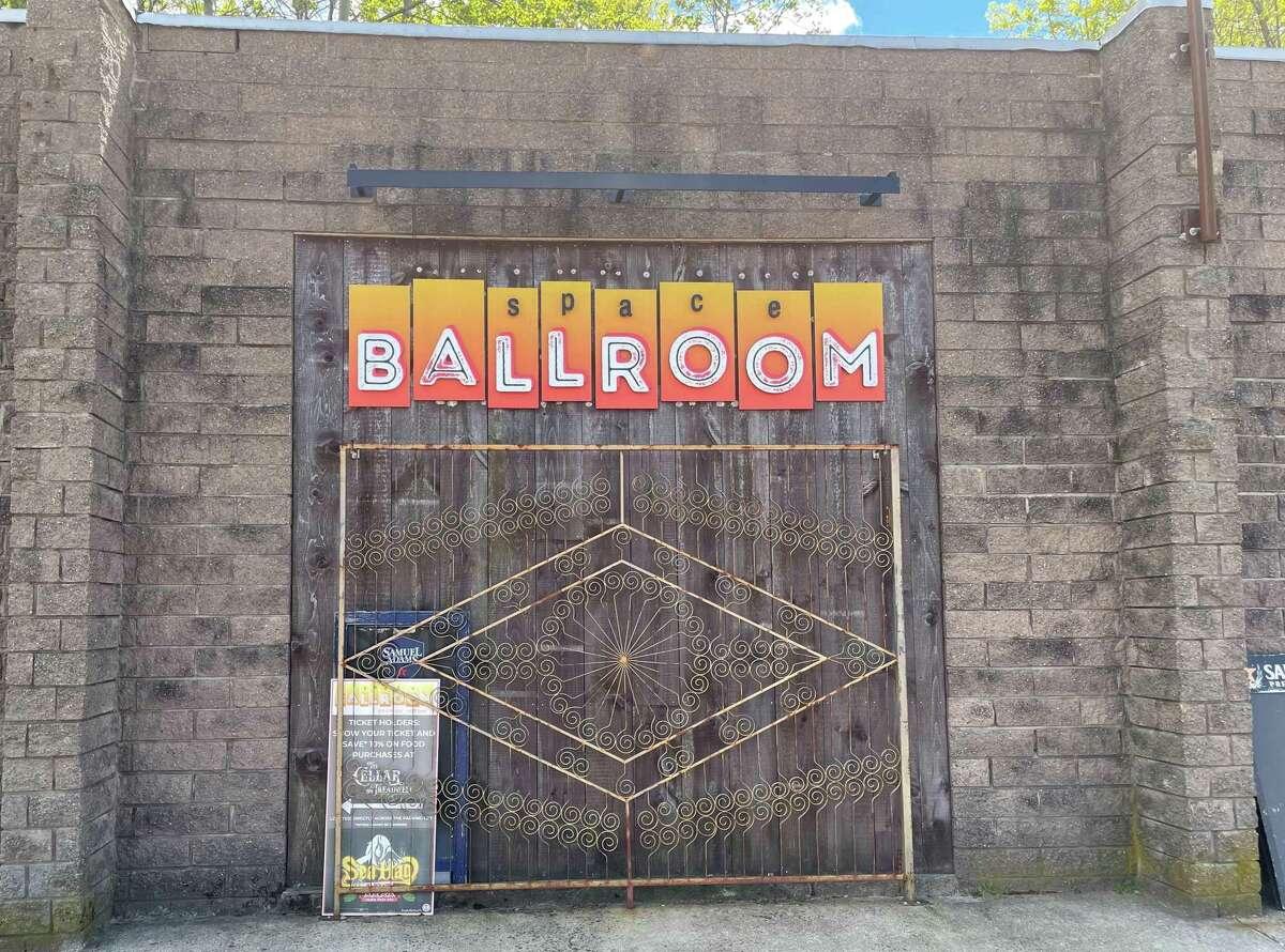 A sign near the entrance to Hamden's Space Ballroom.