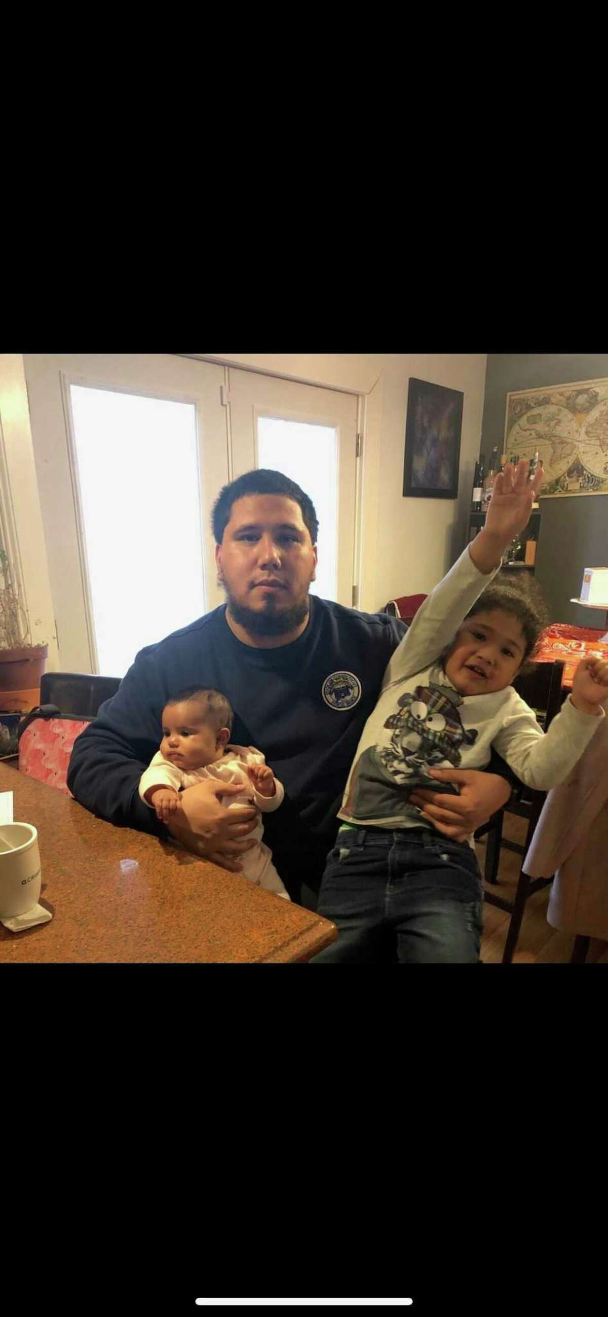 John Corujo, an aspiring New Haven firefighter, recently won a discrimination complaint against the city. Here, he's pictured with his daughter, Joni Corujo, and his son, Kayden Corujo.