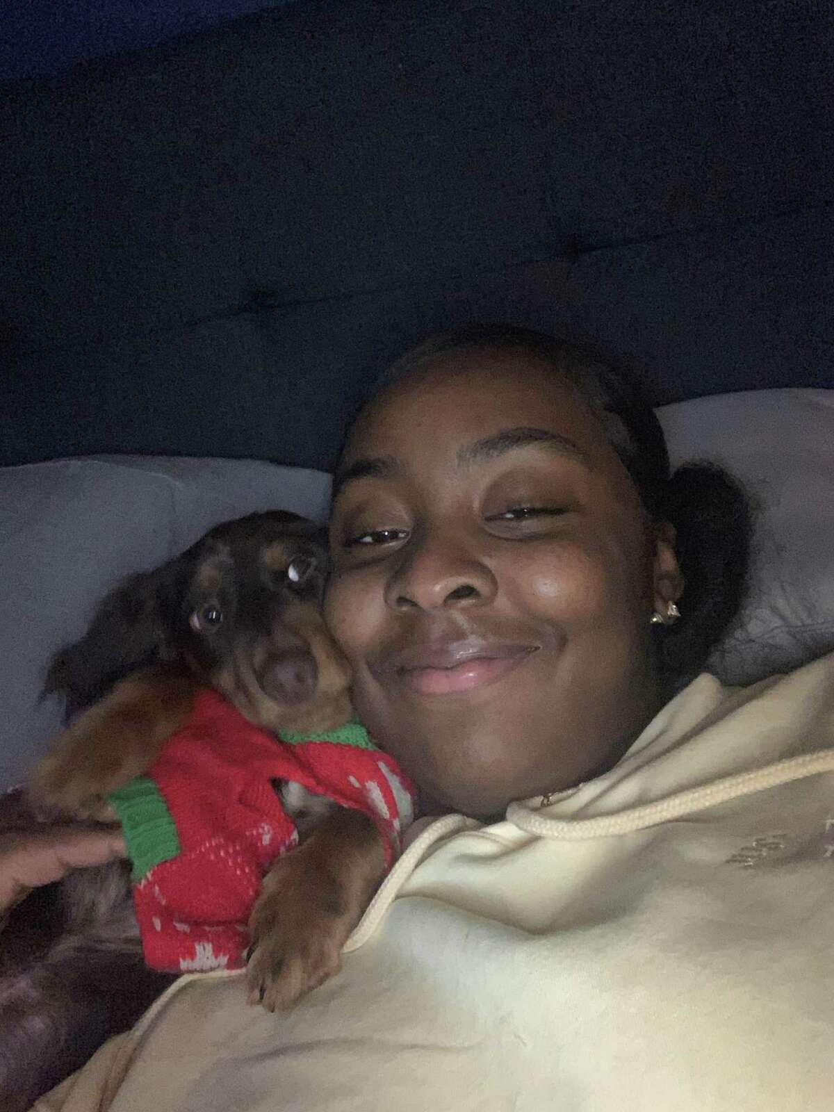 Nadayea Encarnacion seen pictured with her pet dachshund, Bodie, who she claims was unfairly seized by police in a crackdown on a dog-running scheme run out of Stamford.