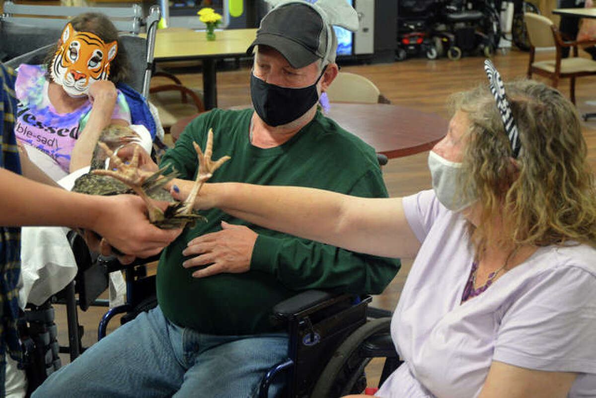 """Edwardsville Care Center presented """"Zoo Day,"""" with a variety of animals for residents to meet and pet, on Wednesday as part of its celebration of National Nursing Home Week."""