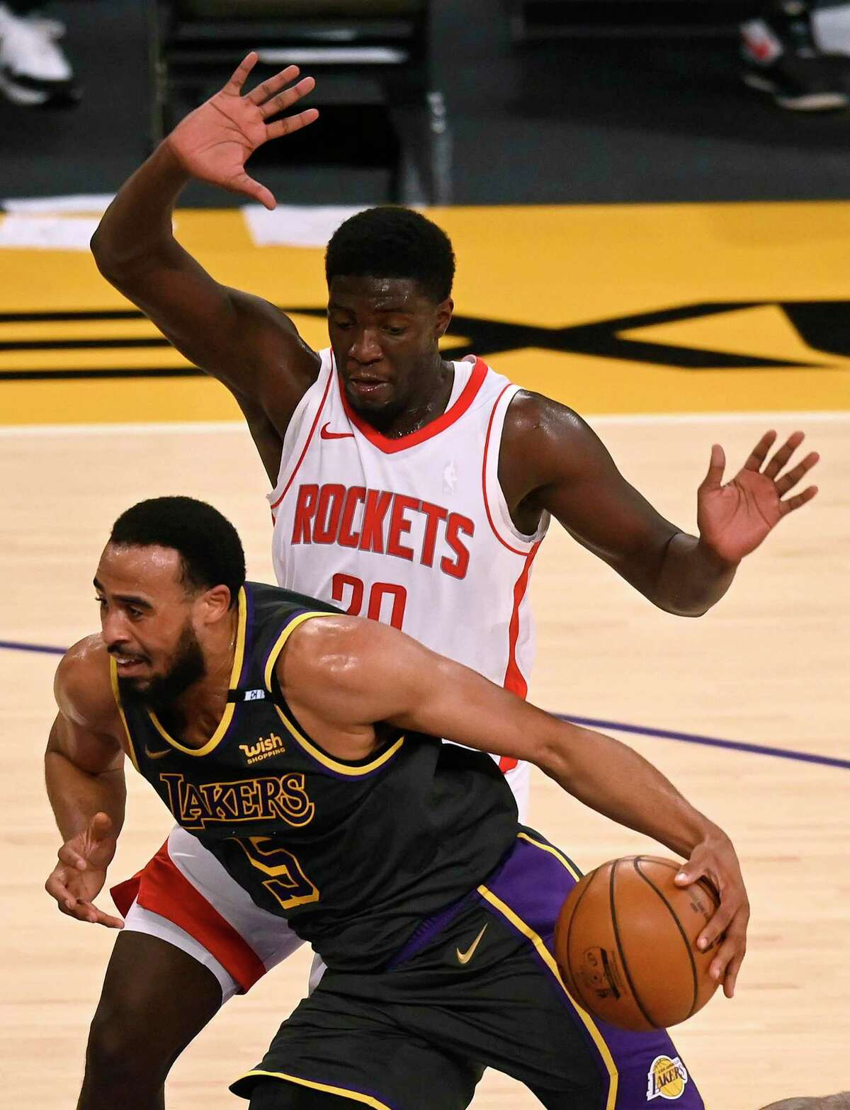 Khyri Thomas, like other Rockets newcomers, has not had time to learn all the team's defensive schemes. Talen Horton-Tucker gets past him on Wednesday.