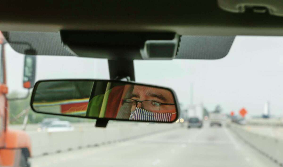 Clayton Harris, a transportation engineer with the Wharton County office of the Texas Department of Transportation's Yoakum District, drives on Interstate 10 from Brookshire to Sealy on April 14, 2021, in Sealy.