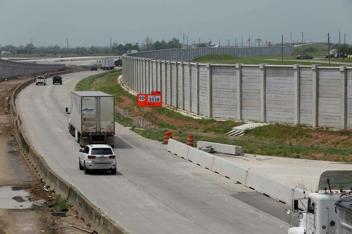 A large gray wall next to I-10 Wednesday, April 14, 2021, in Sealy.