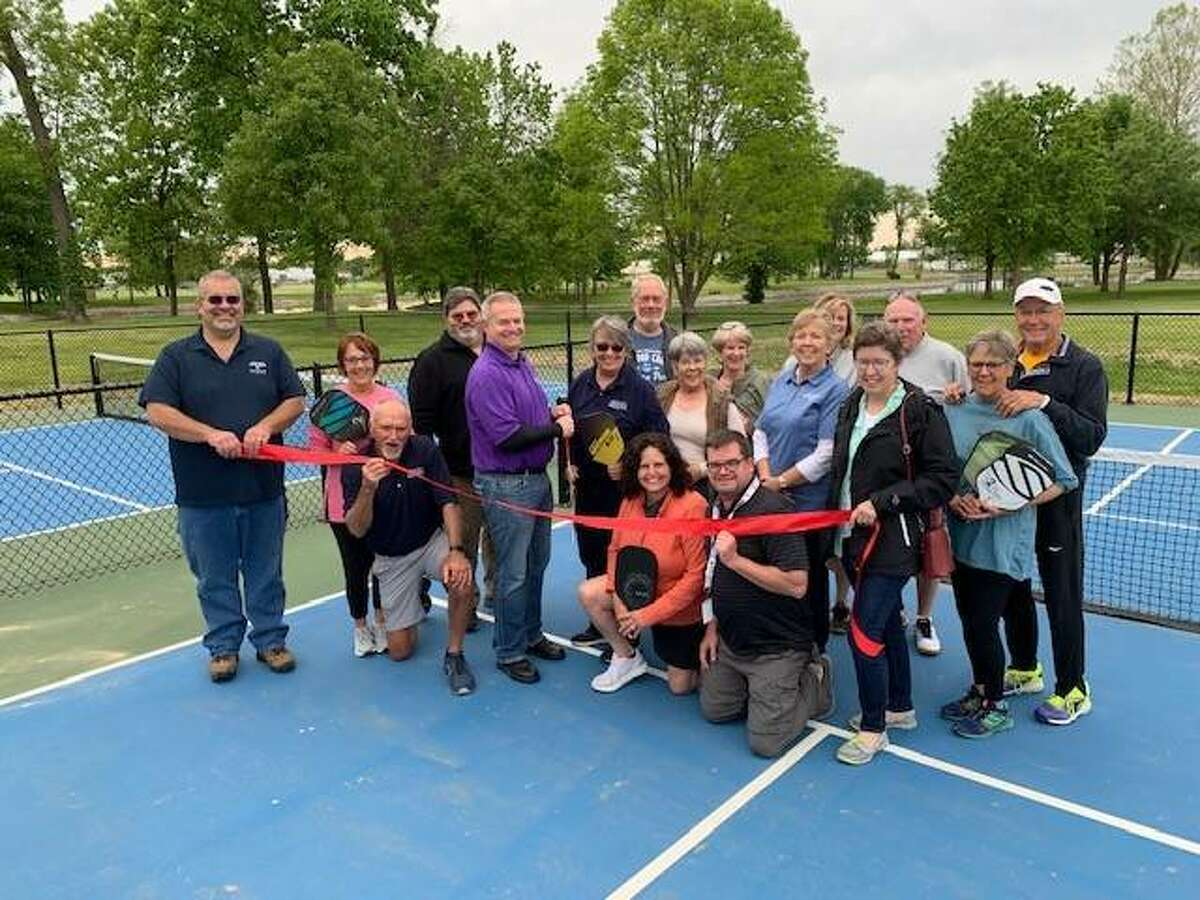 Maryville officials, along with others, participate in a ribbon-cutting hosted by the Troy/Maryville/St. Jacob/Marine Chamber of Commerce Monday in Drost Park.