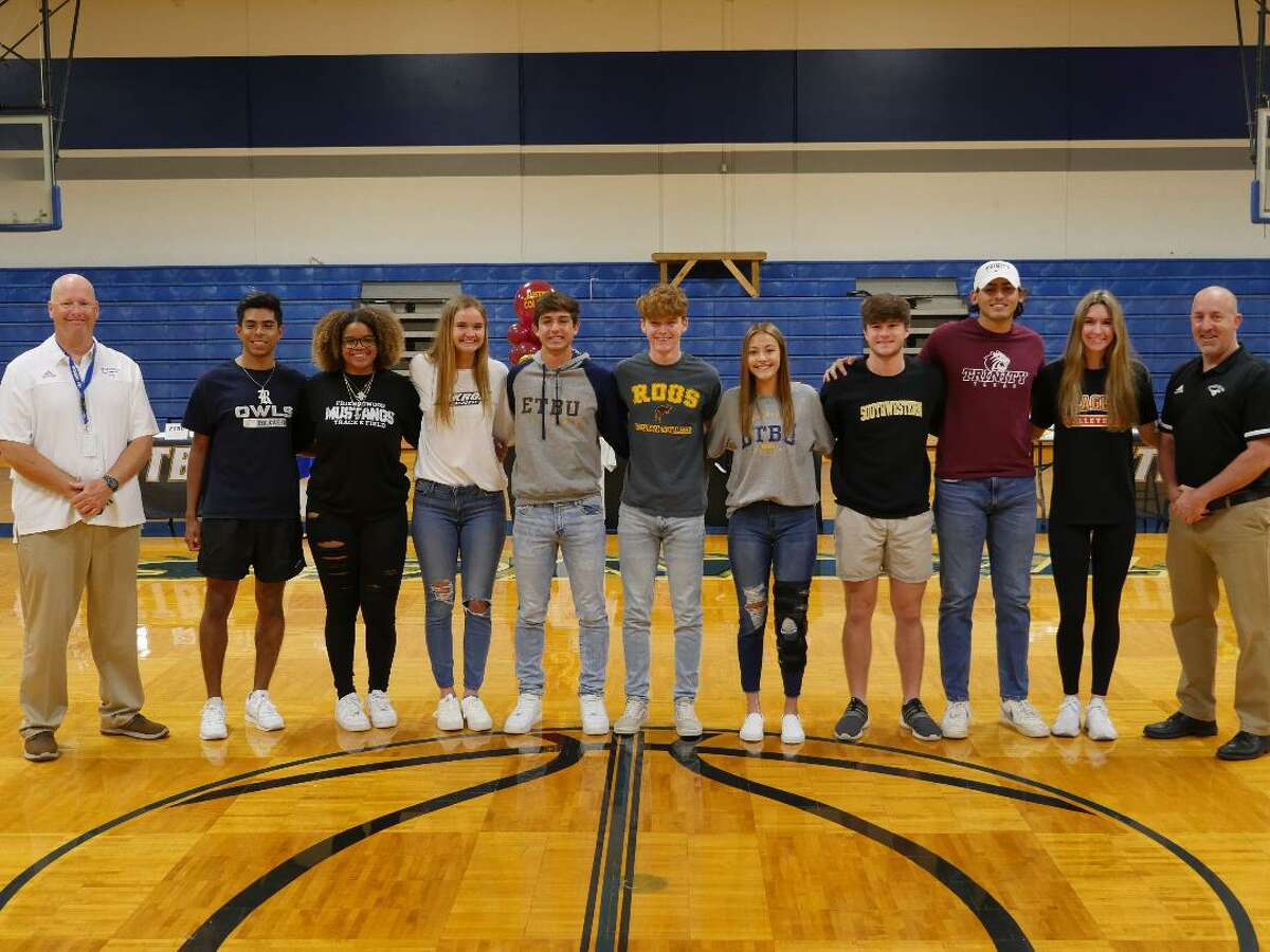 Friendswood athletes joining athletic director Robert Koopmann (left) and girls' athletic coordinator Daron Scott (right) signing national letters of intent included (from left) Patrick Elizondo, Destiny Wilfork, Bryanne Harner, Brady Box, Louis Catchpole, Bailey Havens, Nolan Smith, Matthew Kovacevich and Jordan Norwood.