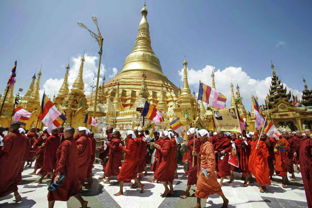 Buddhist monks march down a street in protest in Yangon, despite stern warnings from Myanmar's junta against anti-government demonstrations.