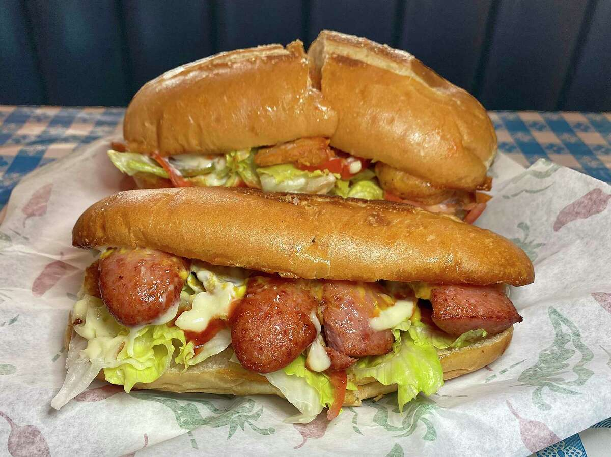 Po'boy choices at Ma Harper's Creole Kitchen on the East Side include smoked sausage, foreground, and fried shrimp.