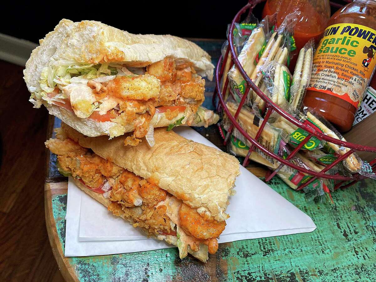 Order a split po'boy at Paris St. Po'Boys in Castroville and you get fried shrimp and fried oysters with lettuce, tomato, pickles, mayo and housemade sauce.