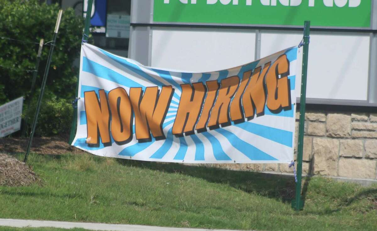 This colorful now hiring sign is one of many that can be spotted throughout Friendswood these days.