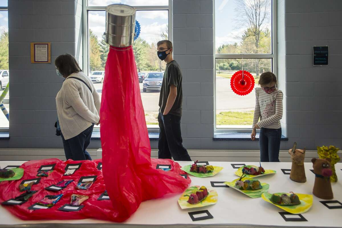Families browse works of art during the Meridian Public Schools art show Wednesday, May 12, 2021 at Meridian Early College High School in Sanford. (Katy Kildee/kkildee@mdn.net)