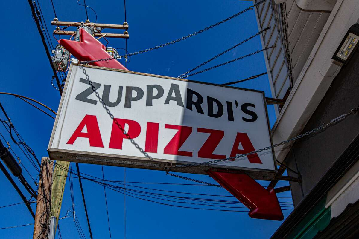 This sign outside Zuppardi's Apizza in West Haven on April 23, 2021.