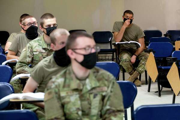 Trainees going through basic training must keep their masks on at all times and sit spaced apart in classrooms.
