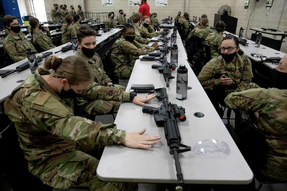 A group of trainees nervously wait for their first chance to fire live rounds during basic training. Photo: Jessica Phelps /Staff Photographer / **MANDATORY CREDIT FOR PHOTOG AND SAN ANTONIO EXPRESS-NEWS/NO SALES/MAGS OUT/TV  © 2021 San Antonio Express-News