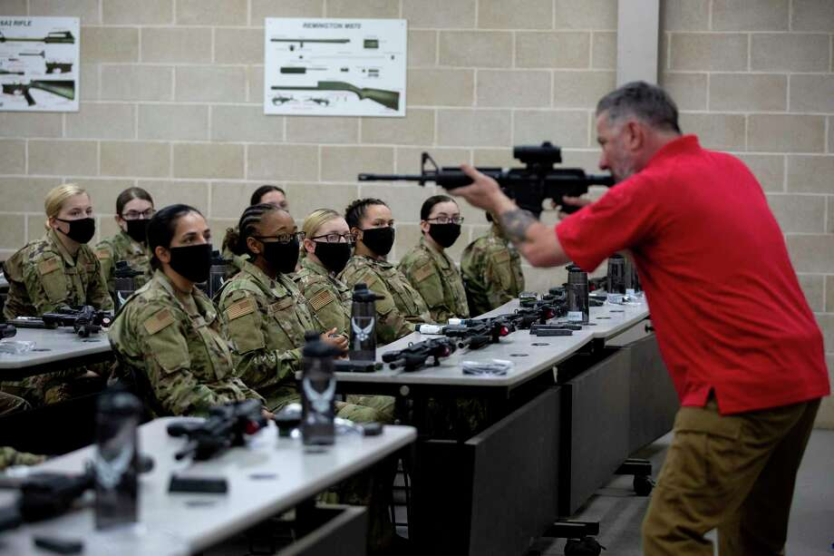 Female trainees are prepped for their first time at the gun range using live rounds during Beast week at Joint Base San Antonio-Lackland. Photo: Jessica Phelps /Staff Photographer / **MANDATORY CREDIT FOR PHOTOG AND SAN ANTONIO EXPRESS-NEWS/NO SALES/MAGS OUT/TV  © 2021 San Antonio Express-News