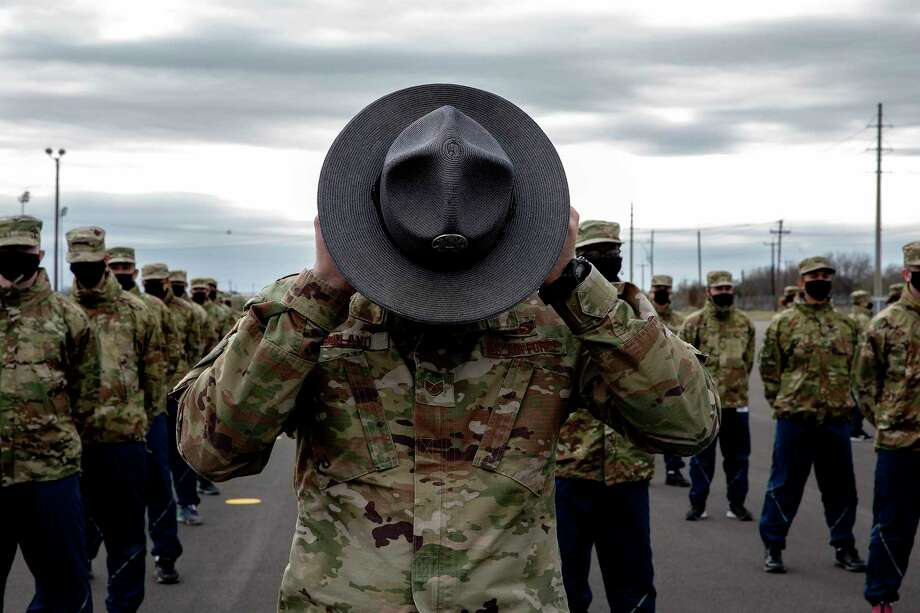 A training instructor at Joint Base San Antonio-Lackland adjusts his hat outside while putting recruits through a drill. Photo: Jessica Phelps /Staff Photographer / **MANDATORY CREDIT FOR PHOTOG AND SAN ANTONIO EXPRESS-NEWS/NO SALES/MAGS OUT/TV  © 2021 San Antonio Express-News