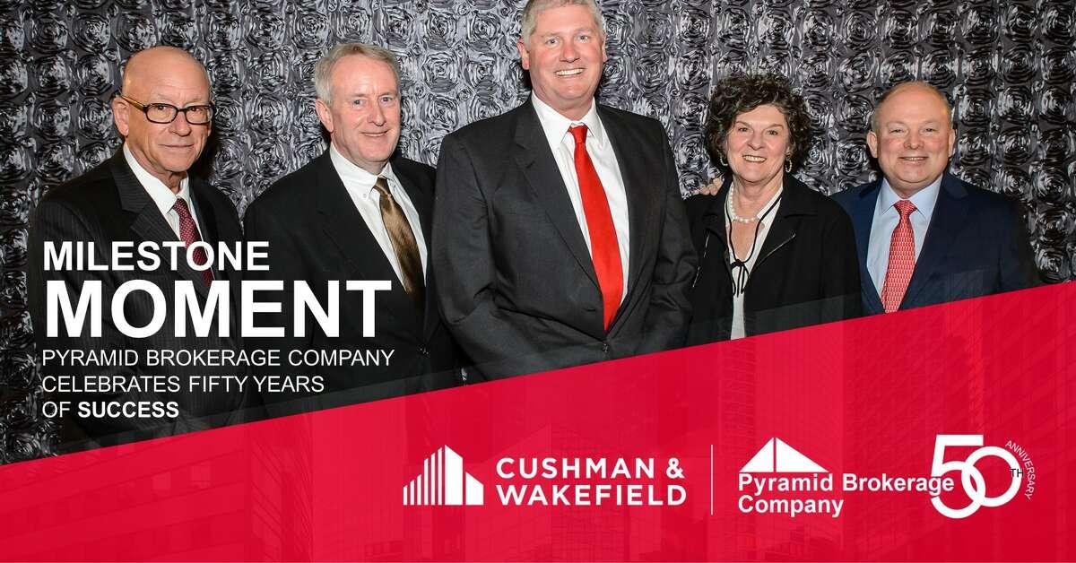 Leaders of the Pyramid Brokerage, left to right: Robert E. Berkey, III (Chief Operating Officer), John L. Clark, Robert A. Schell, Maureen Wilson, John J. Manilla