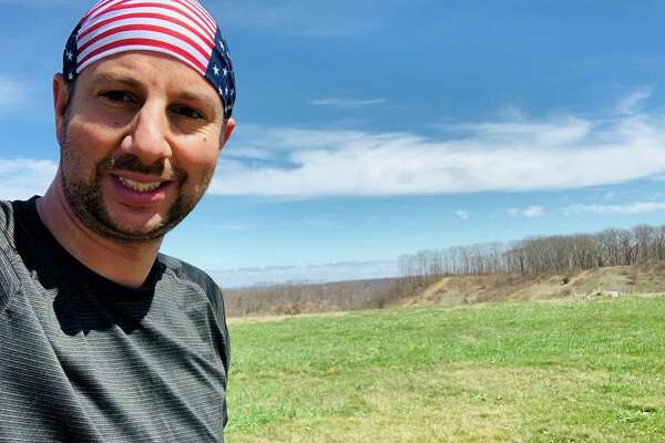 Adam Levine, a respiratory therapist at Hartford Hospital, is running a marathon to raise money for the hospital's COVID-19 relief fund.