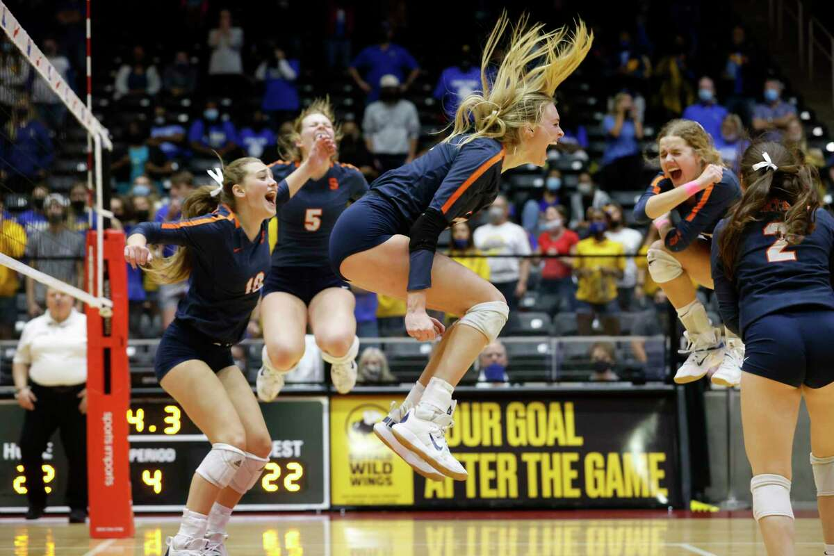 Seven Lakes players Katarina Teahen (10), Casey Batenhorst (5) Ally Batenhorst (14) Emma Manuel (4) and Grace Lanier (2) celebrate a point against Klein during the last match as they went on to win the Conference 6A State High School volleyball championship in Garland, Texas on Dec. 12, 2020. (Michael Ainsworth/ Contributor)