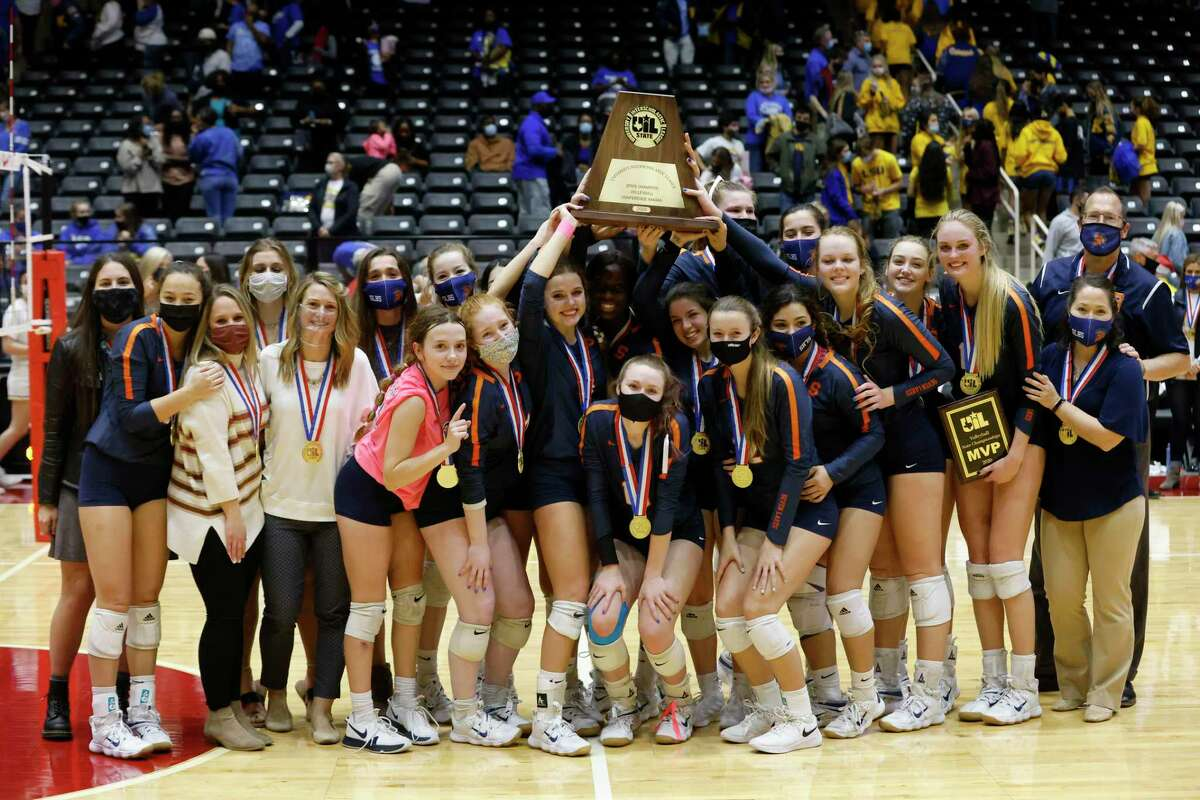 Seven Lakes team members hold up the championship trophy after they defeated Klein to win the Conference 6A State High School volleyball championship in Garland, Texas on Dec. 12, 2020. (Michael Ainsworth/ Contributor)