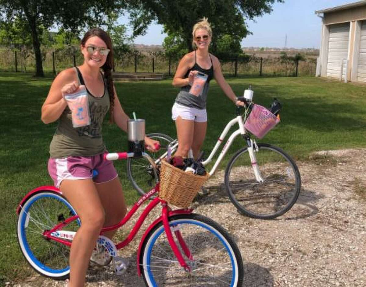 Visitors to ErmaRose Winery grab some daiquiris-to-go on April 16, 2020.