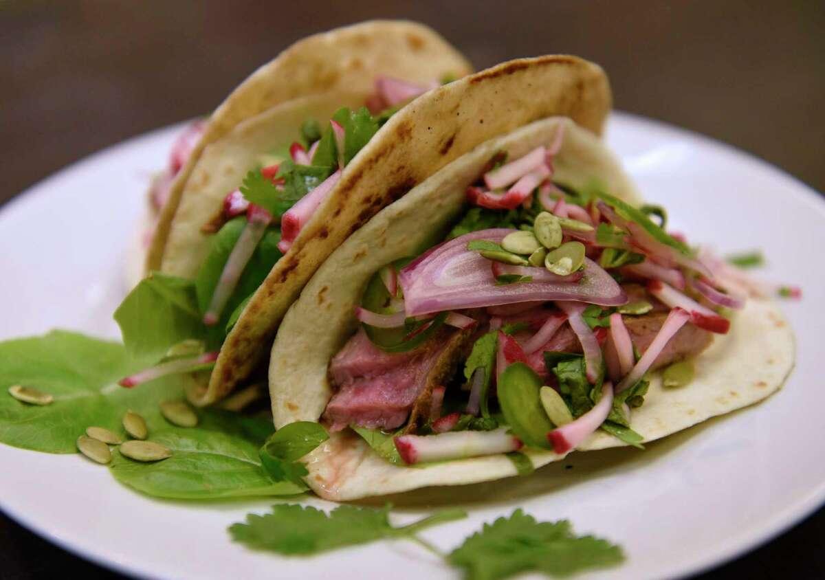 Caroline Barrett's steak tacos with spicy radish salsa. (Lori Van Buren/Times Union)