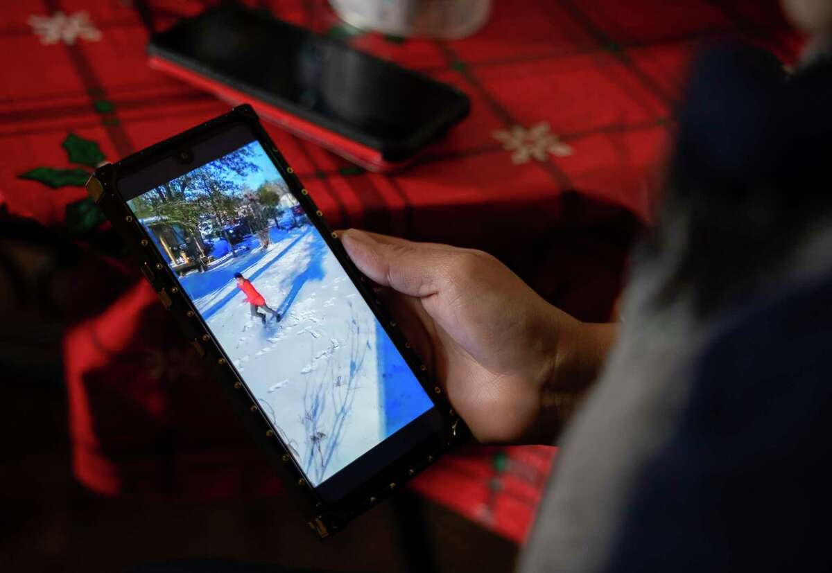 Maria Pineda watches a video of her son, 11-year-old Cristian Pavon Pineda, playing in the snow for the first time. Pavon Pineda died of carbon monoxide poisoning during the mid-February Texas freeze.