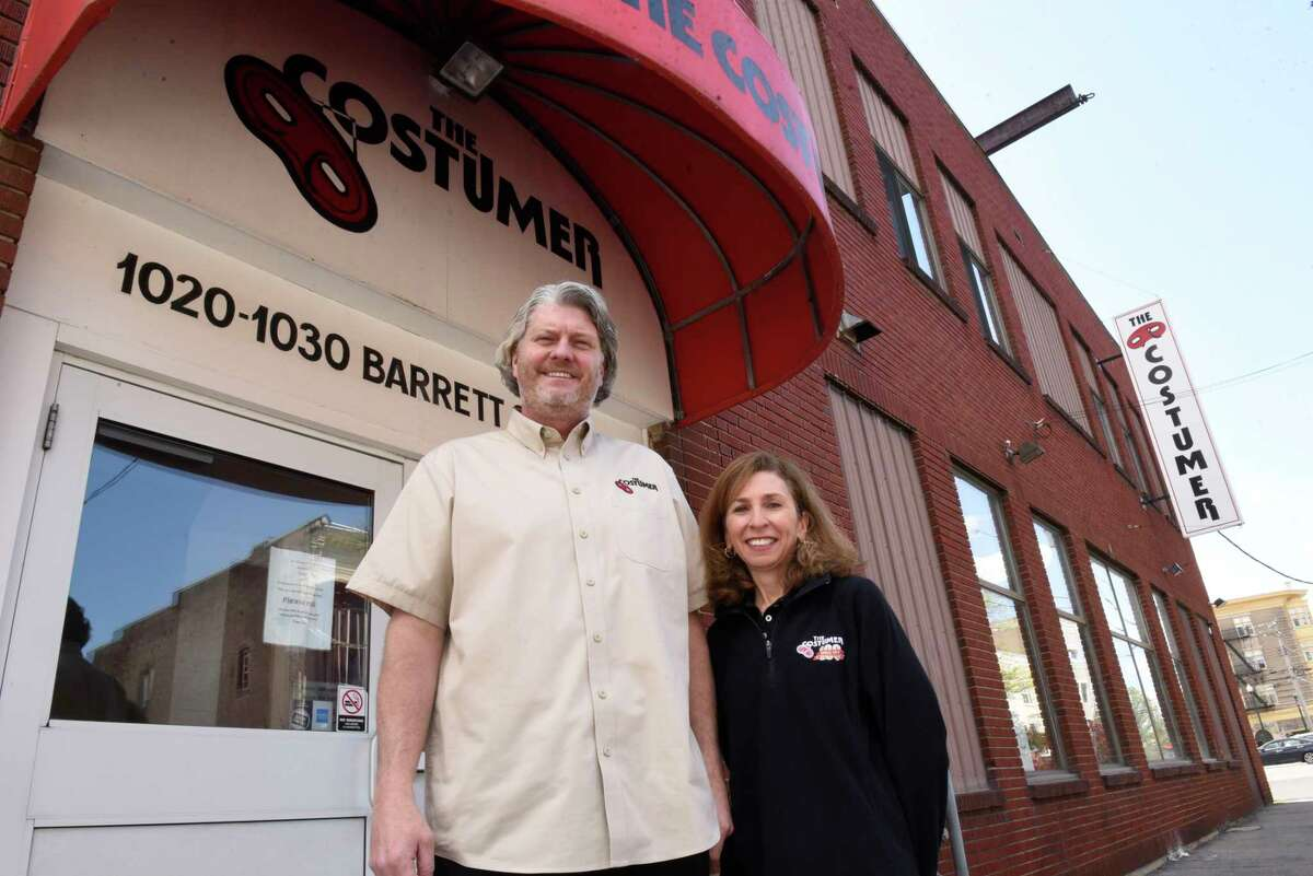 Owners Erik Johnsen and his wife Bonnie Johnsen stand outside The Costumer on Thursday, May 13, 2021 in Schenectady N.Y. (Lori Van Buren/Times Union)
