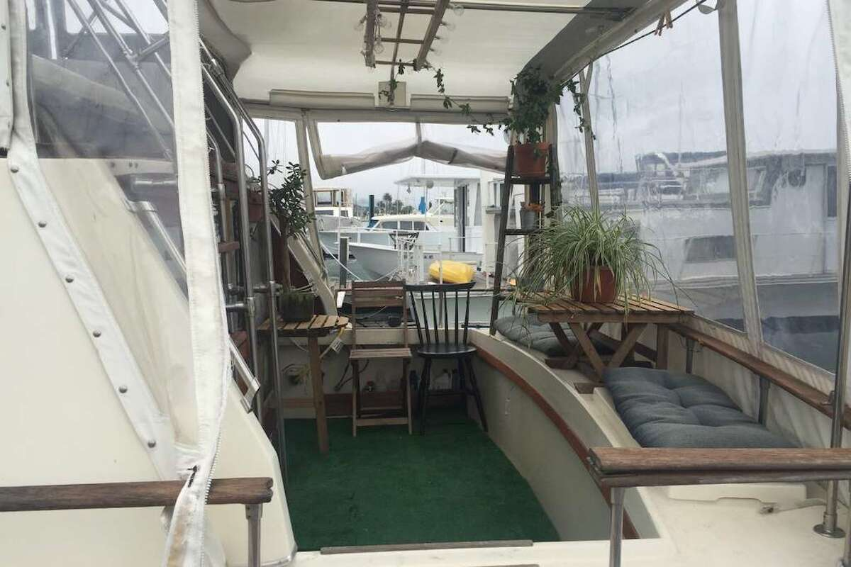 The boat has high ceilings, lots of light and Bimini covers on the upper and rear decks.