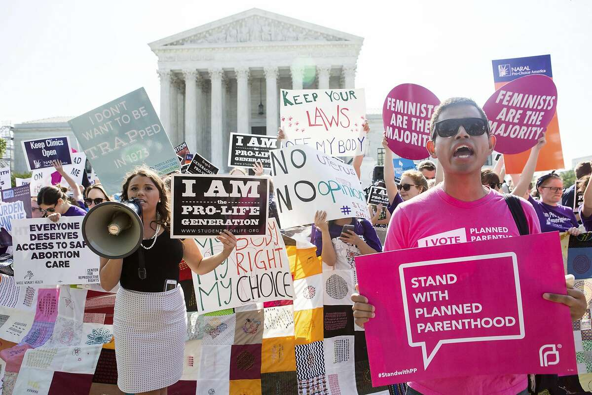 Pro-abortion rights and anti-abortion protesters rally in front of the U.S. Supreme Court in Washington, June 27, 2016. The court is expected to finish its term today with a decision on abortion ñ a case deciding the constitutionality of two provisions of a Texas law regulating abortion could affect access to abortions for millions of women in several states. (Zach Gibson/The New York Times)