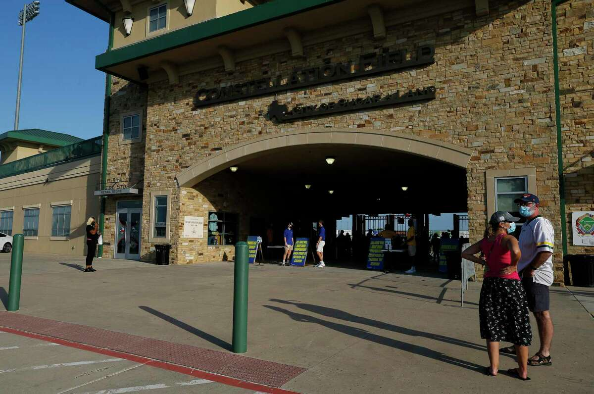 Baseball fans attend the opening game of the Constellation Energy League at Constellation Field on Friday, July 10, 2020, in Sugar Land, Texas.