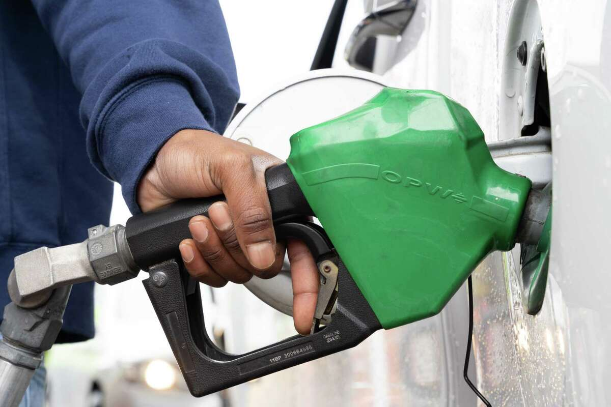 A man refuels at a gas station on May 12, 2021 in Fayetteville, North (Photo by Sean Rayford/Getty Images)