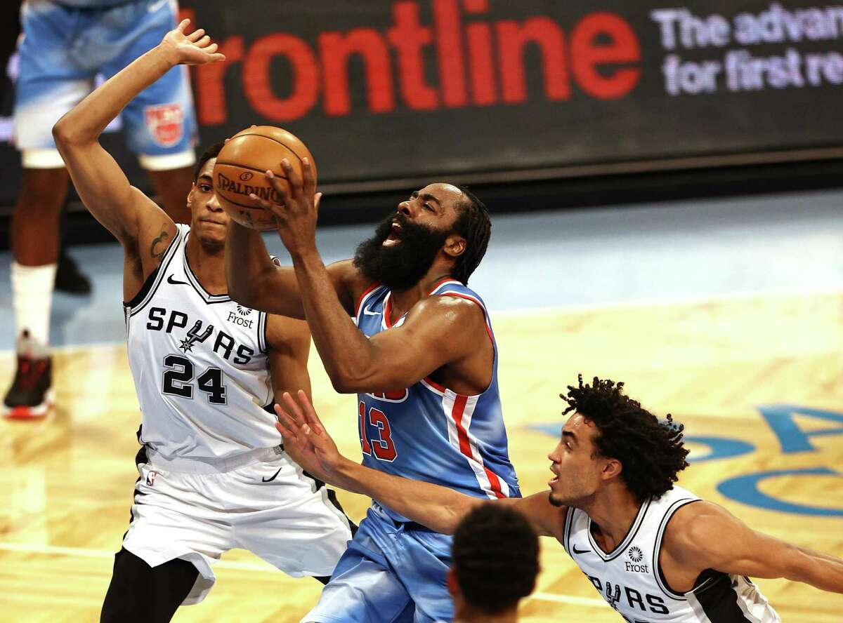 NEW YORK, NEW YORK - MAY 12: James Harden #13 of the Brooklyn Nets takes a shot as Devin Vassell #24 of the San Antonio Spurs defends at Barclays Center on May 12, 2021 in the Brooklyn borough of New York City.NOTE TO USER: User expressly acknowledges and agrees that, by downloading and or using this photograph, User is consenting to the terms and conditions of the Getty Images License Agreement. (Photo by Elsa/Getty Images)