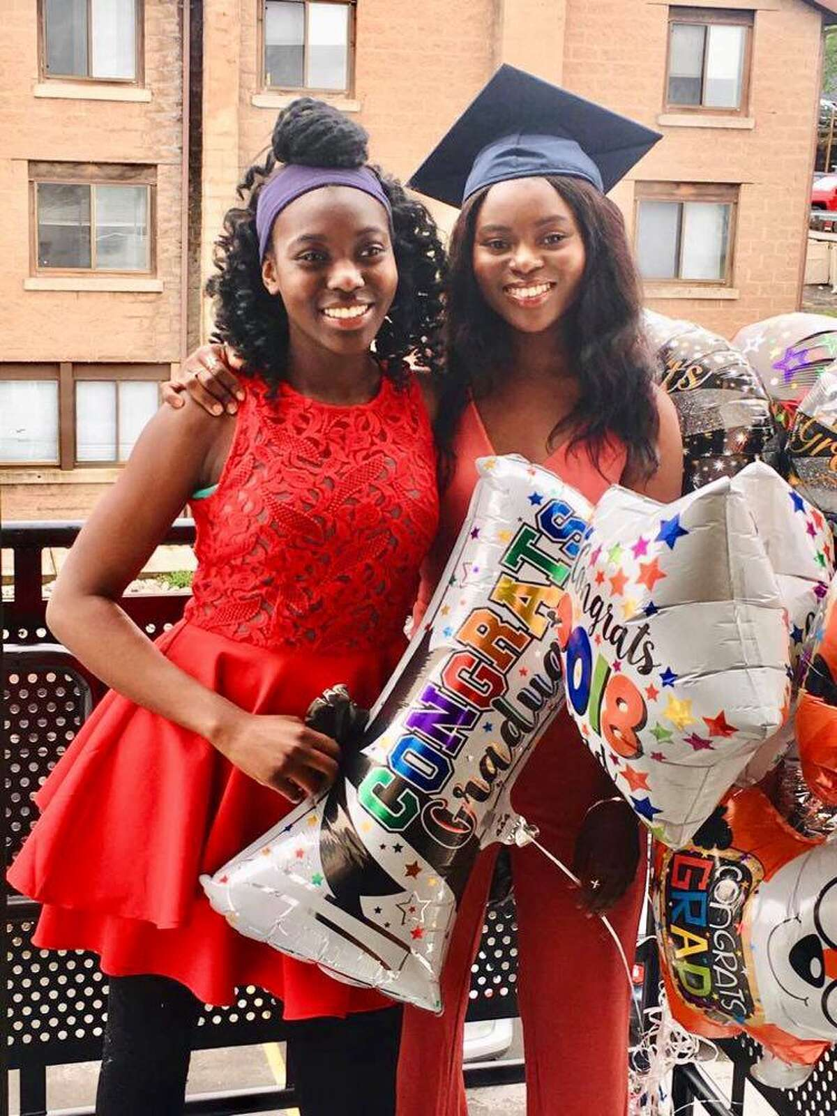 Rebecca Akinwale, left, is valedictorian for the Class of 2021 at Albany Leadership Charter School. Her sister, Tofunmi Akinwale, earned the distinction in 2014. The siblings have made history as the first family to have two ALCS valedictorians. Rebecca credits her close relationships with teachers and staff, as well as her support system at home, for helping her achieve this accomplishment. Tofunmi, who attended Syracuse University after graduating from ALCS, is extremely proud of her younger sister and knows that their parents' sacrifices have paid off. Tofunmi graduated with a degree in computer science. She lives in California and works for IBM. Rebecca will attend SU in the fall.
