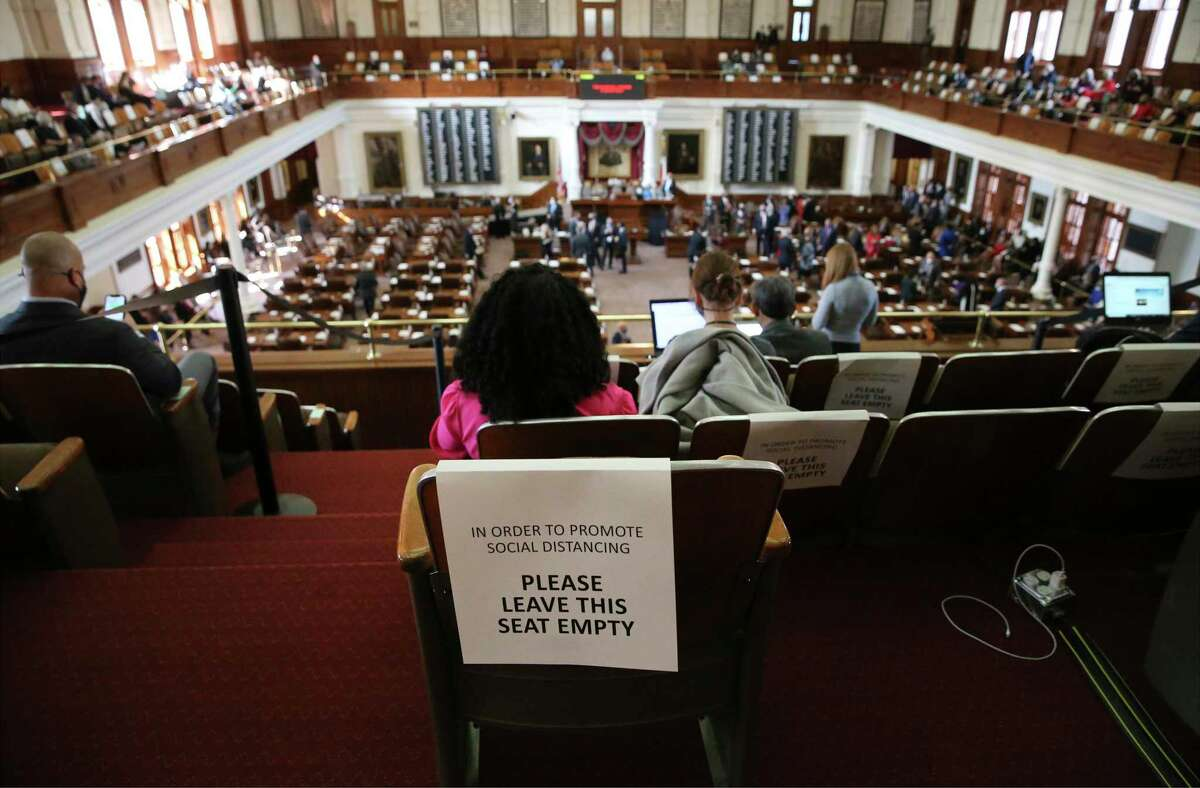 Seats were marked to keep people socially distanced during the convening of the 87th Texas Legislature in Austin on Tuesday, Jan. 12, 2021.