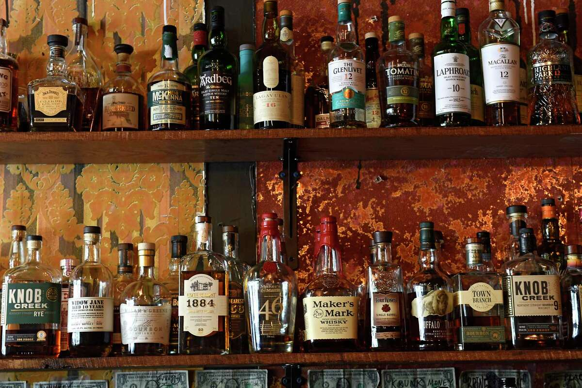 The whiskey collection behind the bar at the Whiskey Pickle in Troy. (Lori Van Buren/Times Union)