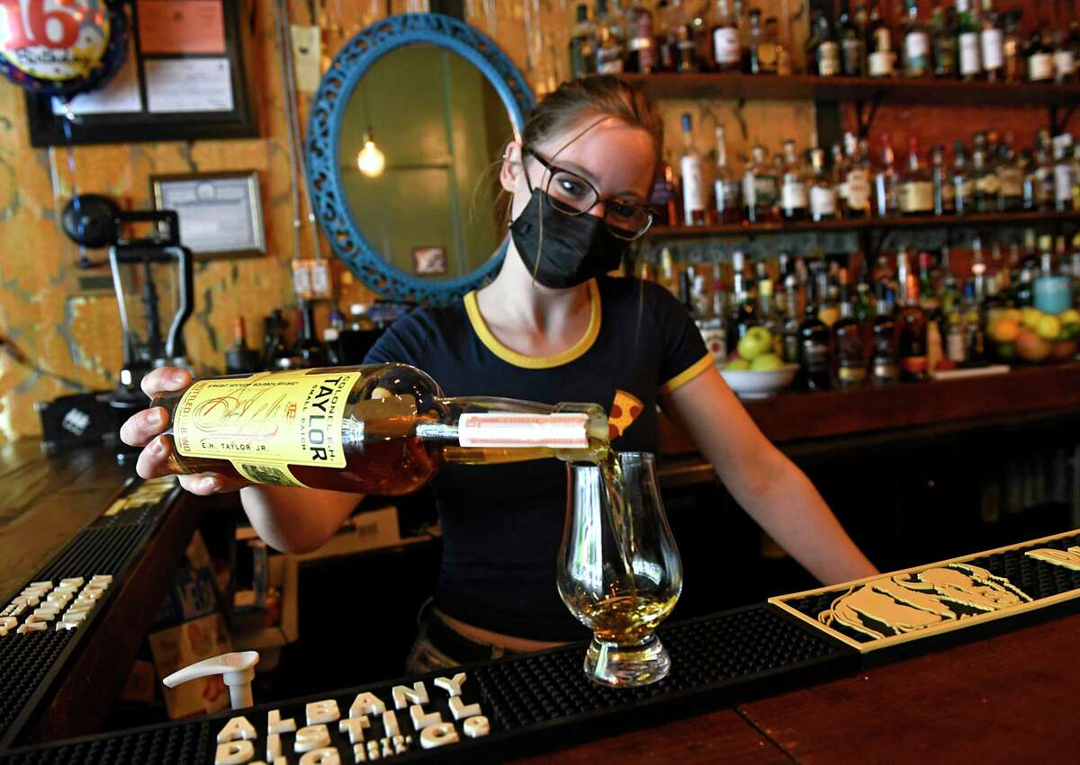 Co-owner Erin Kehoe pours a glass of Colonel E.H. Taylor bourbon whiskey at the Whiskey Pickle on Wednesday, May 12, 2021 in Troy, N.Y. (Lori Van Buren/Times Union)
