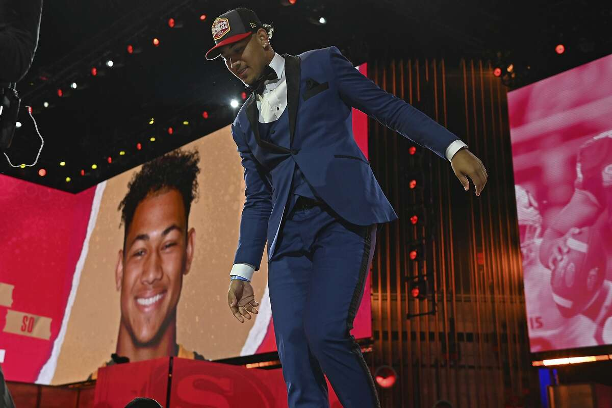 North Dakota State quarterback Trey Lance walks down the runway after he was chosen with the third overall pick by the San Francisco 49ers in the first round of the NFL football draft Thursday April 29, 2021, in Cleveland. (AP Photo/David Dermer)