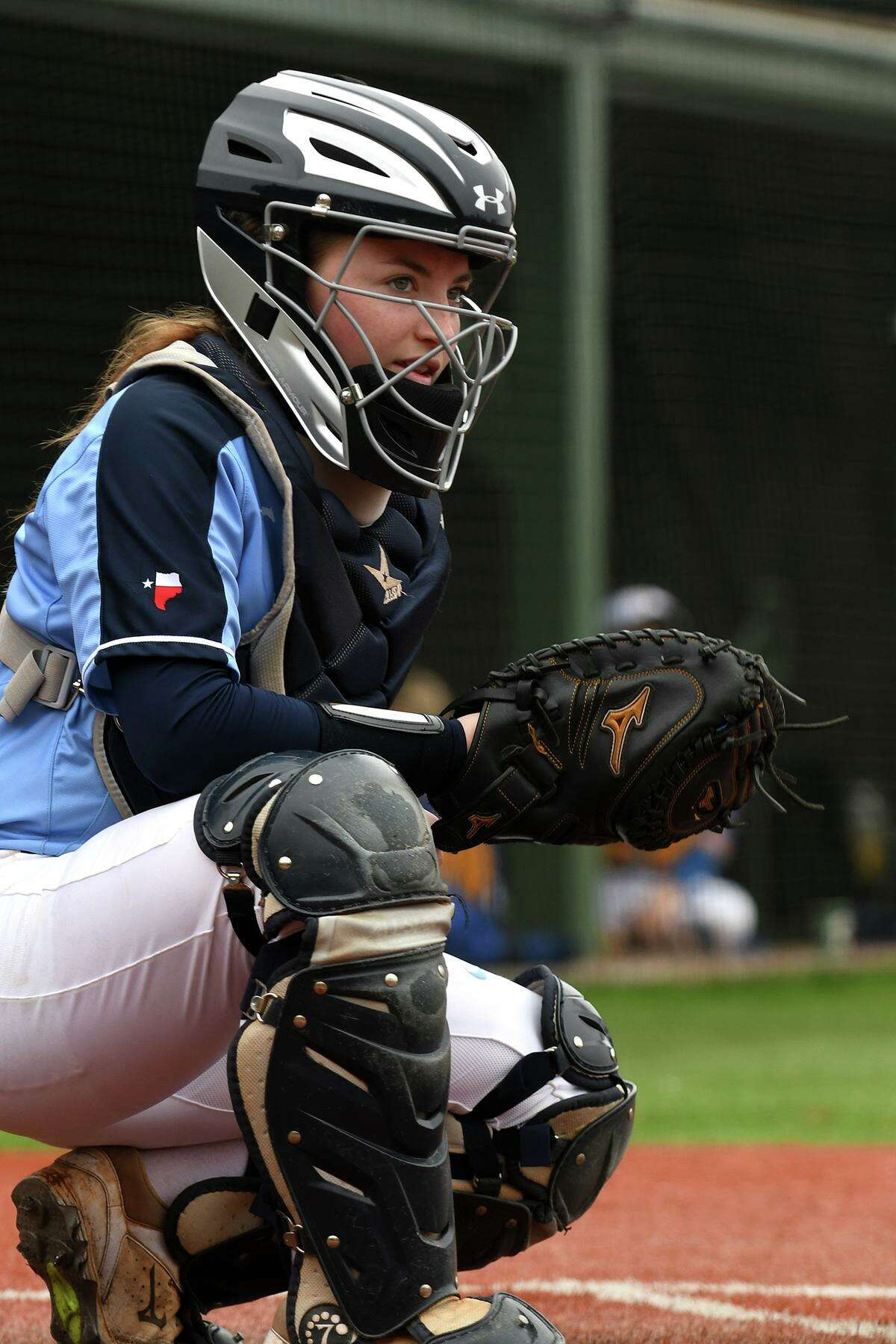 Kingwood catcher Taylor Vannett checks the Mustang's dugout for signals against Klein during their matchup at the Lone Star Cup High School Softball Tournament at the Scrap Yard Sports Complex in Conroe on March 2, 2019.