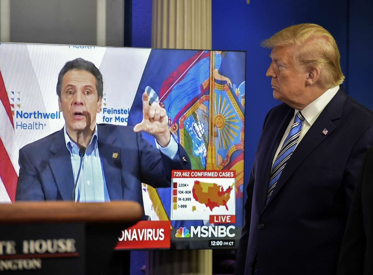 At a coronavirus briefing, President Trump shows video of Andrew Cuomo.