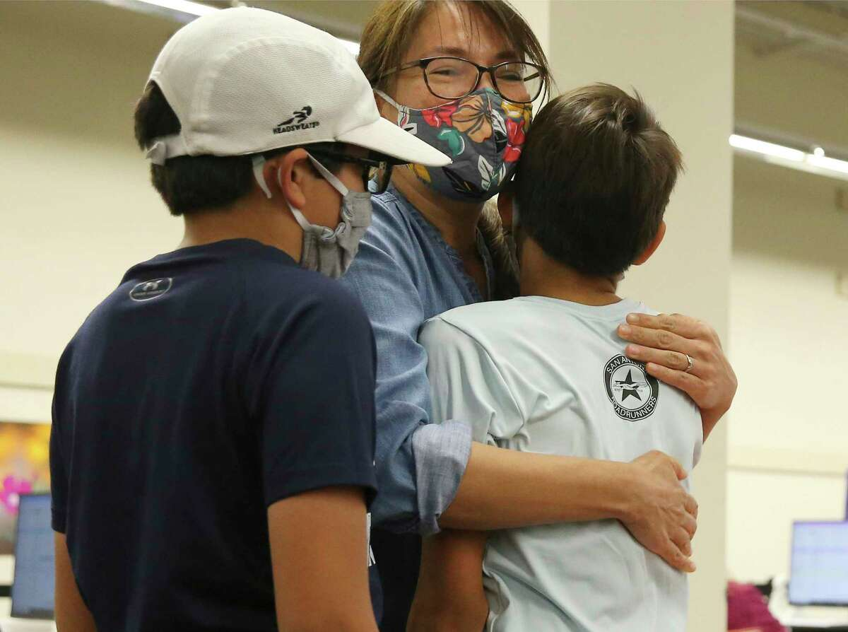 Catarina Vasquez gives her 12-year-old son, Joaquin, a hug after he receives the Pfizer Covid-19 vaccine at University Health's vaccine center at Wonderland of the Americas Mall on Thursday, May 13, 2021. Bexar County officials announced on Monday that more than 1 million residents have received at least one dose of a COVID-19 vaccine.
