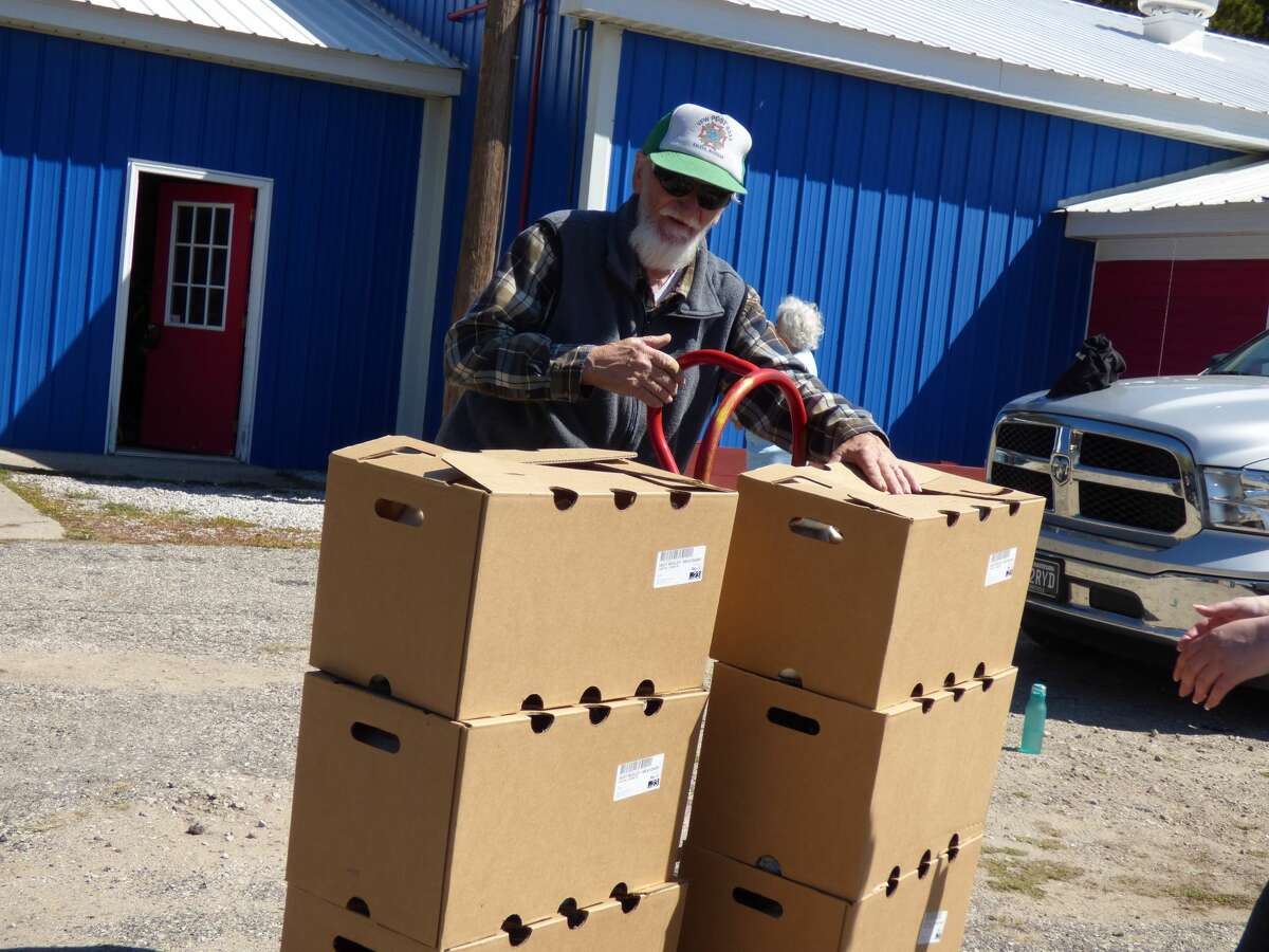 Richard Schafer of the Kaleva VWF loads food boxes for the USDA Farmers to Families program Thursday. The program is set to end in May.