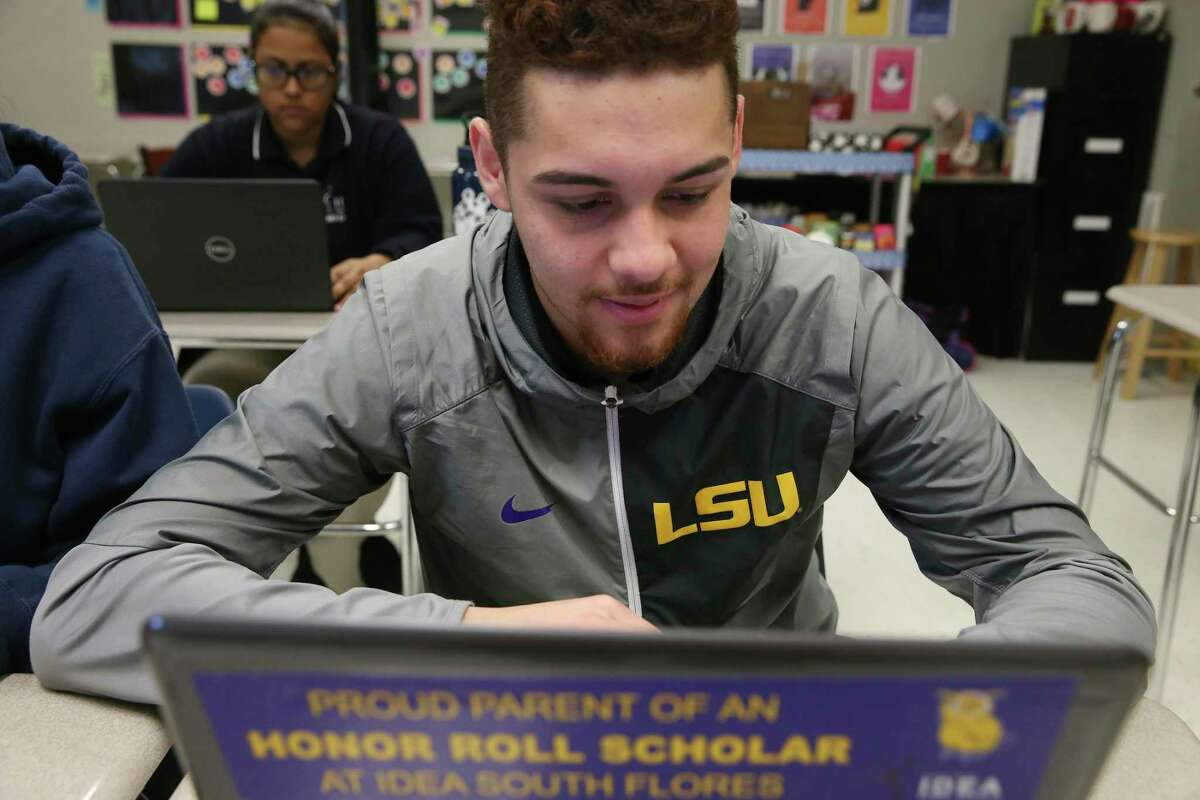 A student with IDEA public schools reviews a college financial aid package. Research shows charter schools have benefited host districts.