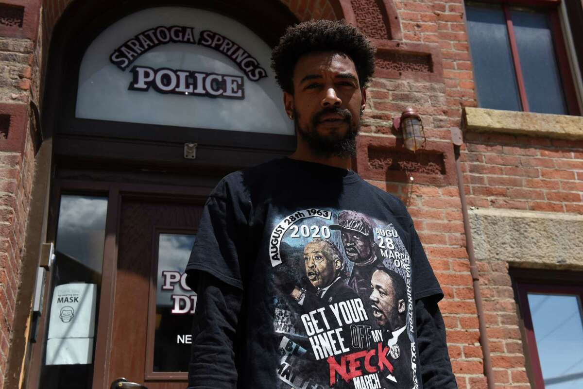 Black Lives Matter activist Lexis Figuereo stands outside the Saratoga Springs Police Station on Thursday, May 13, 2021, in Saratoga Springs, N.Y. (Will Waldron/Times Union)
