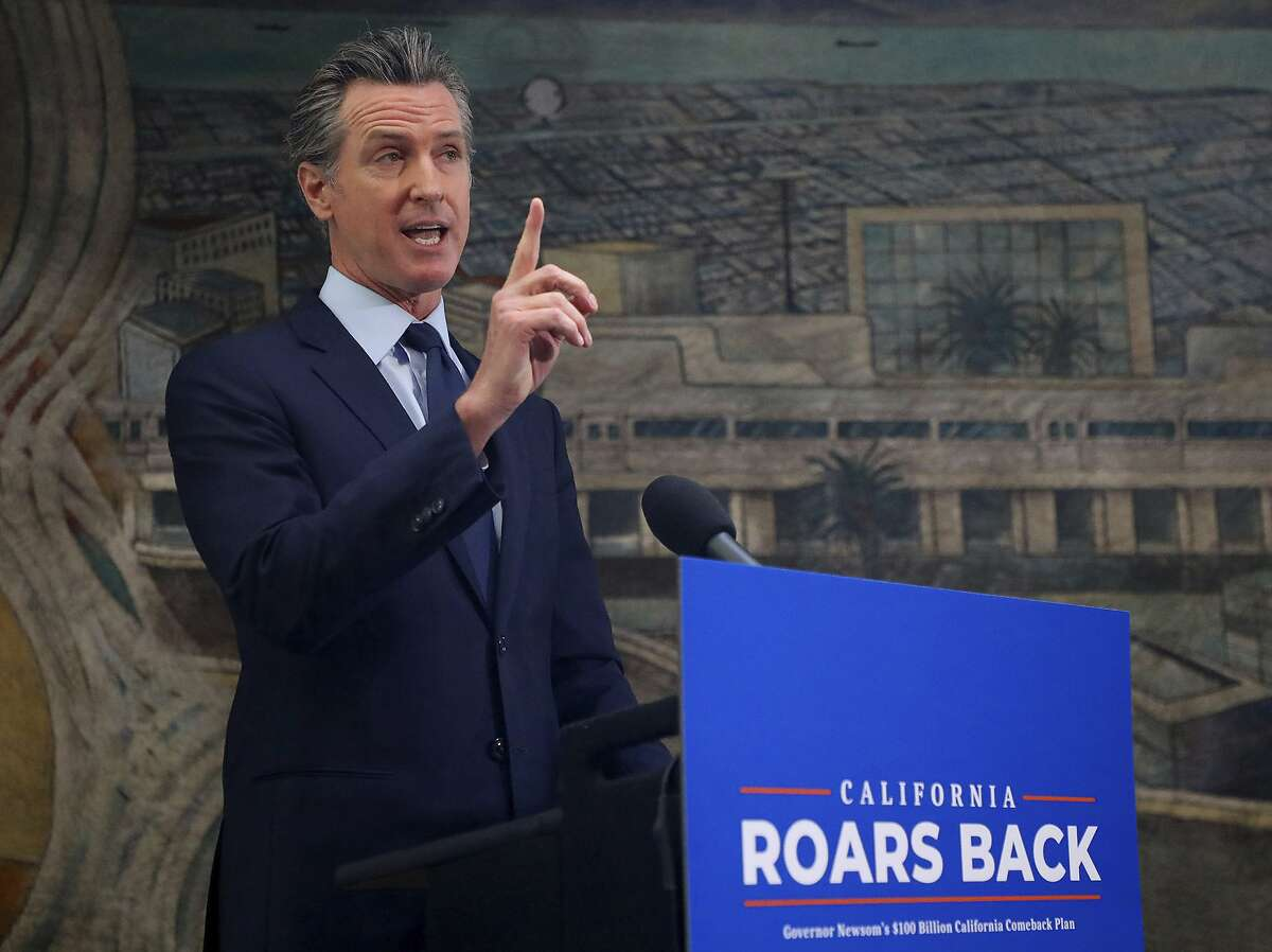 California Gov. Gavin Newsom takes part in a news conference at The Unity Council on Monday, May 10, 2021, in Oakland, Calif. Millions of poor and middle-class Californians would get tax rebates of up to $1,100 under a proposal unveiled Monday by Democratic Gov. Newsom, as part of a broader pandemic recovery plan made possible by an eye-popping $75 billion budget surplus. (Aric Crabb/Bay Area News Group via AP)